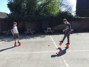 Charlie playing skilt football.