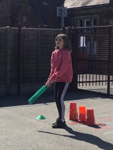 Alexa playing cricket in the sunshine.
