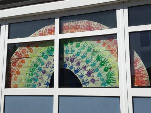 A rainbow of friendship welcoming everyone into our school.