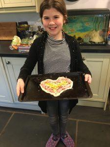 Josie making pizza